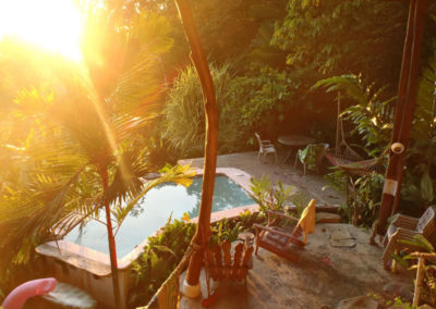 Early morning sunshine form high above the pool area
